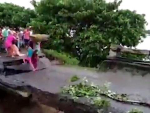 Horrific moment woman and child are swept to their deaths in flood