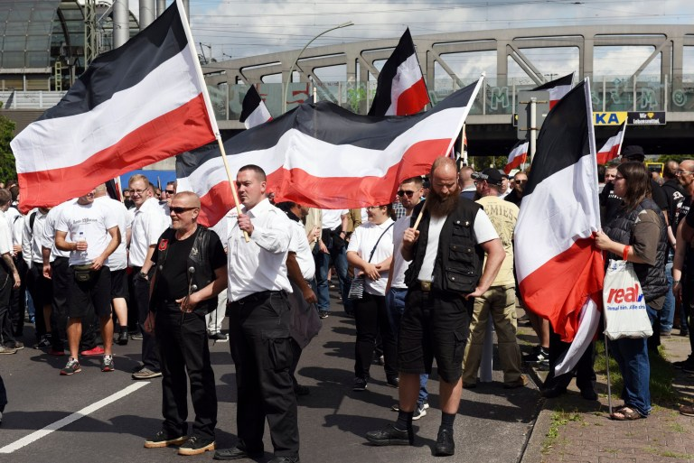 Nazis march through Berlin waving flag of Hitler's Third Reich