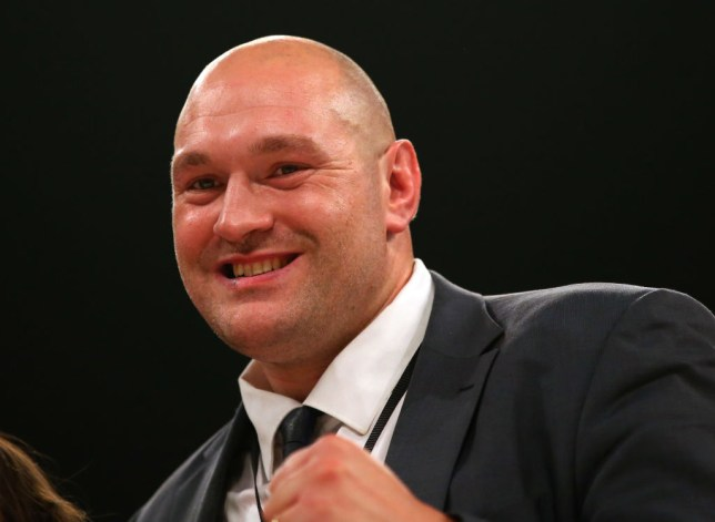 Tyson Fury poses with his fits raised