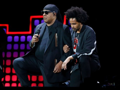 Stevie Wonder 'takes a knee' in solidarity with NFL players after Donald Trump attacks protests