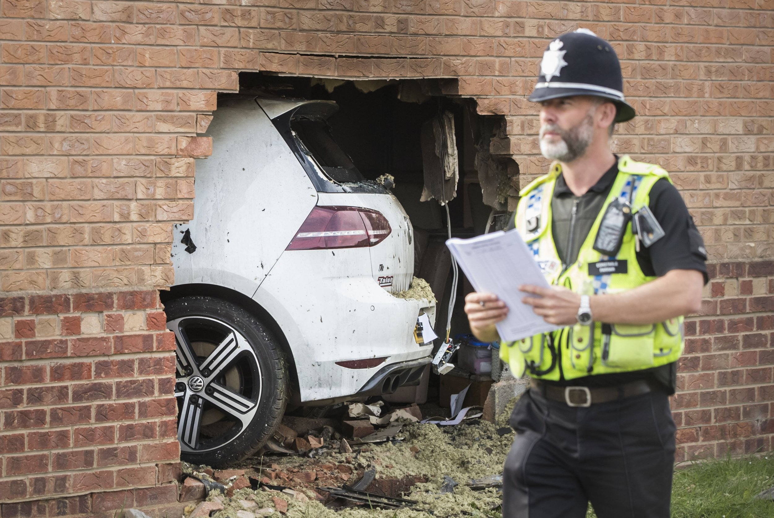 Man 'watching TV on his sofa' among four injured after car ploughs through the wall of a house
