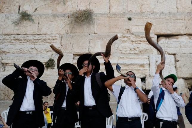 Ultra-Orthodox Jewish men blowing the Shofar at the Western Wall