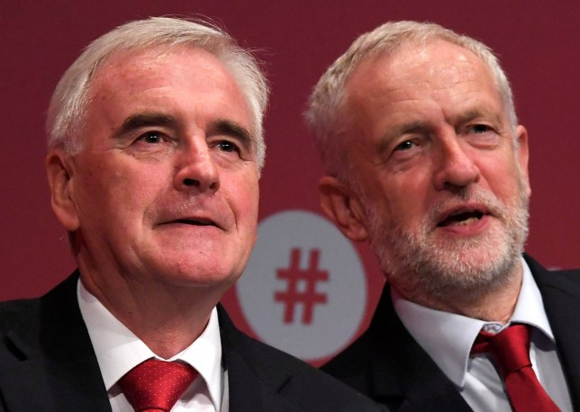 Britain's opposition Labour Party leader Jeremy Corbyn (R) applauds as Shadow Chancellor John McDonnell reacts after delivering his keynote speech at the Labour party Conference venue in Brighton, Britain, September 25, 2017. REUTERS/Toby Melville