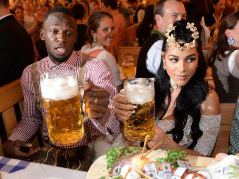Usain Bolt enjoys Oktoberfest in traditional lederhosen with girlfriend Kasi Bennett