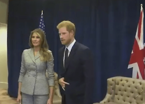 What does Prince Harry's strange hand signal mean as he meets