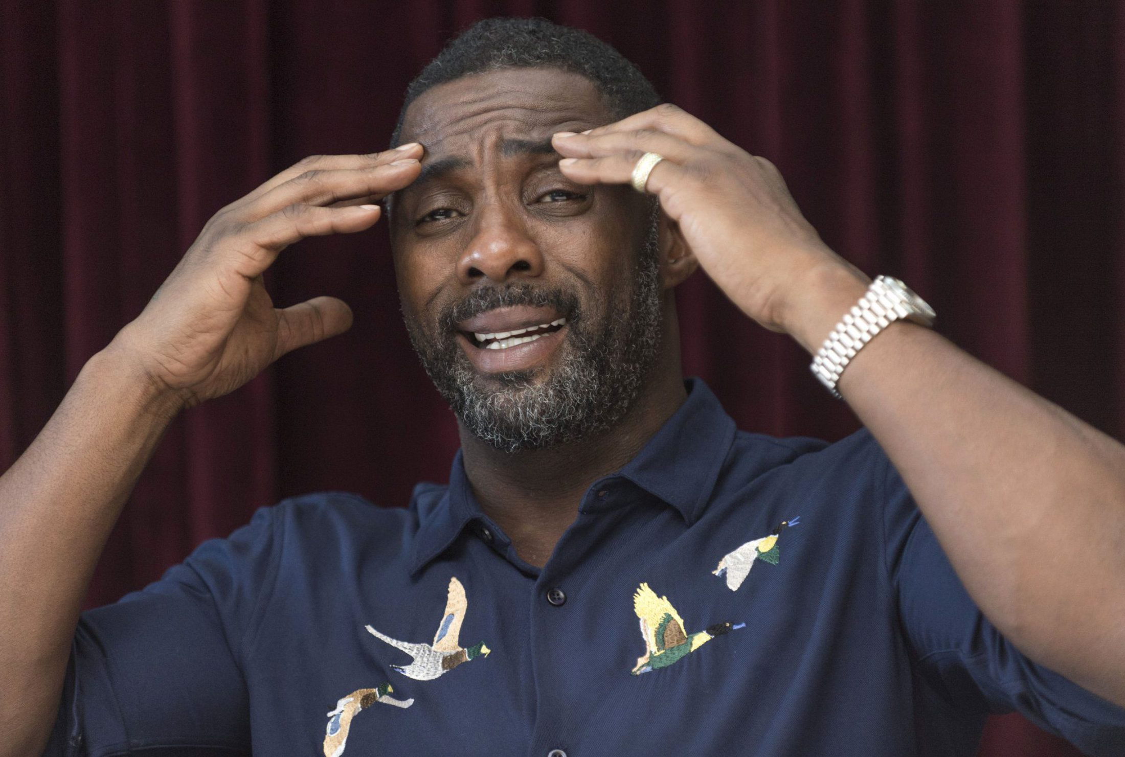 Idris Elba spills the tea on awkward moment between Taylor Swift and Kanye West and Prince Harry being 'in love'