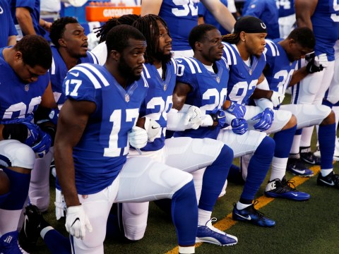 Football player cut from team for kneeling during national anthem