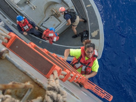 Sailors and a dog stranded at sea for five months finally rescued by navy