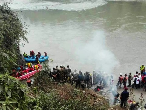 Bus full of people plunges into river killing at least 31 in Nepal