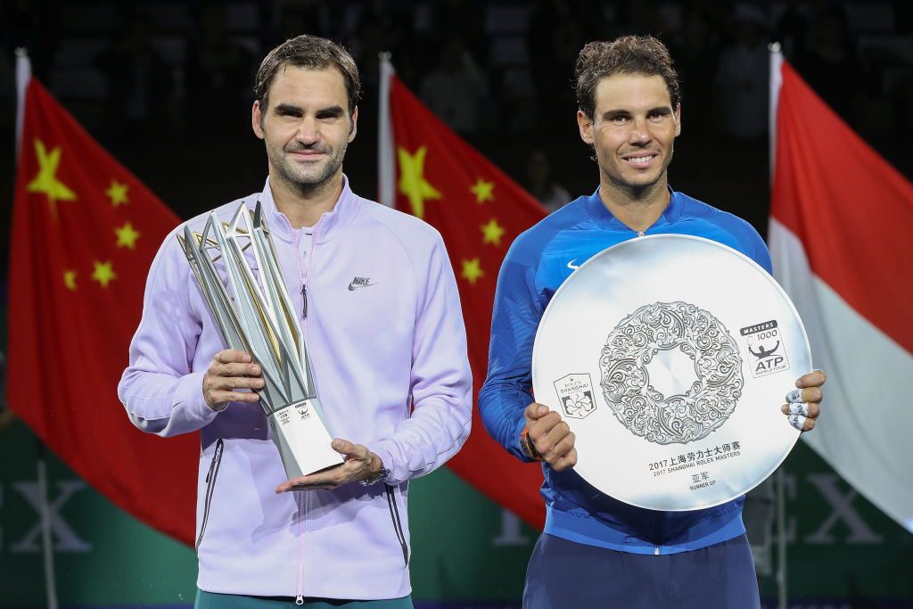 Federer and Nadal holding their prizes after coming first and second in the Shanghai Masters