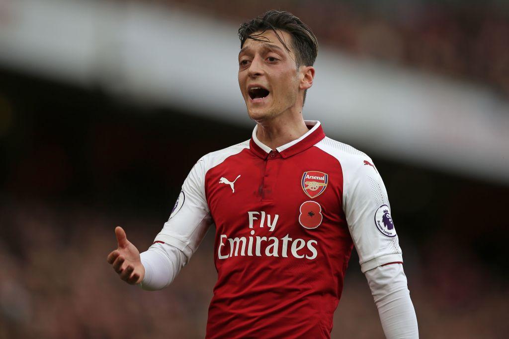 Arsenal's midfielder Mesut Ozil gestures.