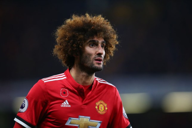 Marouane Fellaini has a concentrated look on his face