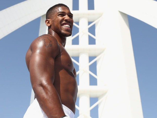Anthony Joshua smiles at the top of a Dubai skyscraper