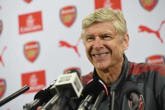 Arsene Wenger smiles as he listens to a question