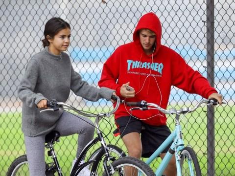 Justin Bieber and Selena Gomez 'jet off on romantic Valentine's getaway' following rehab stint