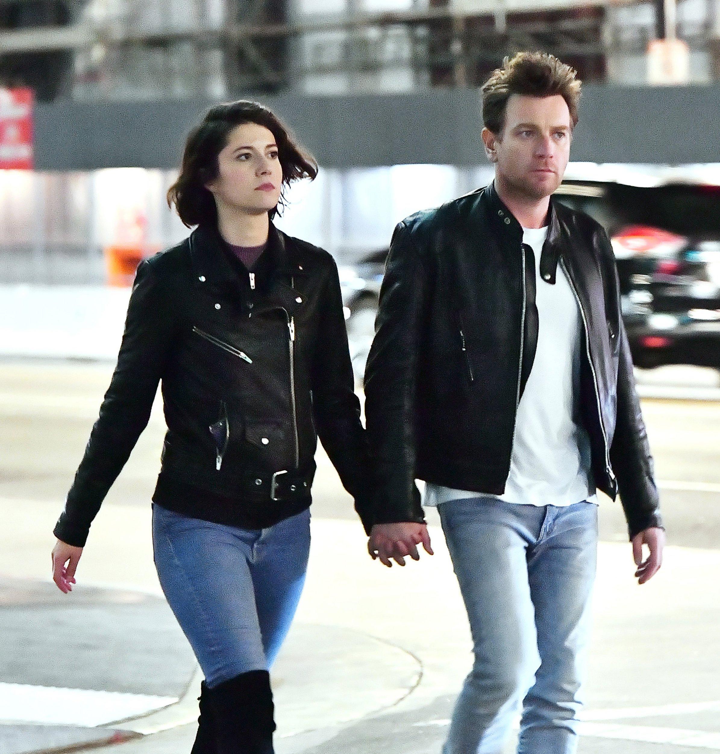 Ewan McGregor and Mary Elizabeth Winstead are hand-in-hand as they walk through LA