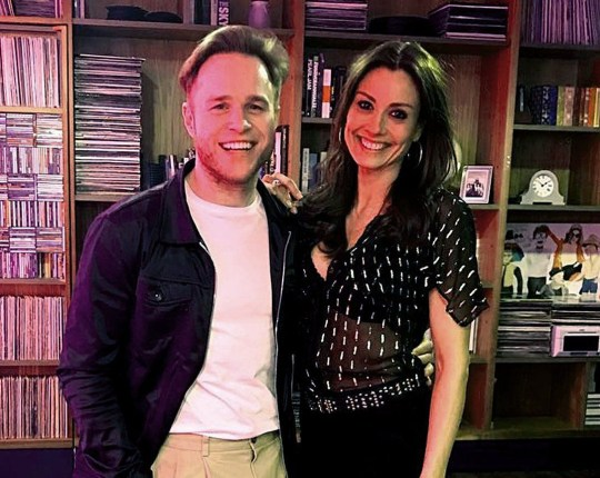 Olly and Mel pose together for a picture