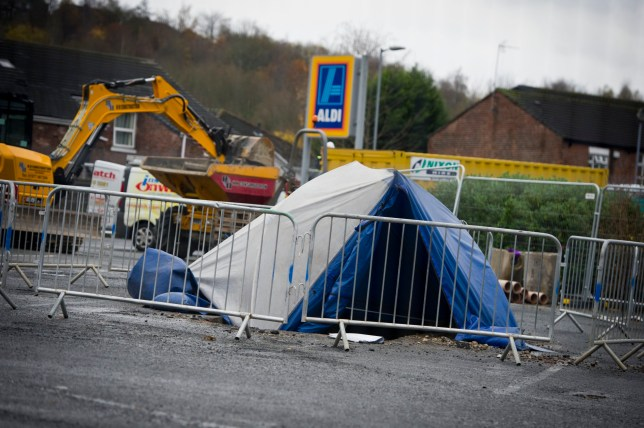 Human remains including a SKULL are discovered buried underneath an Aldi car park