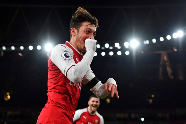 Ozil celebrates his goal (