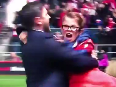 Lee Johnson swings ball boy around in celebration after Manchester United giant-killing