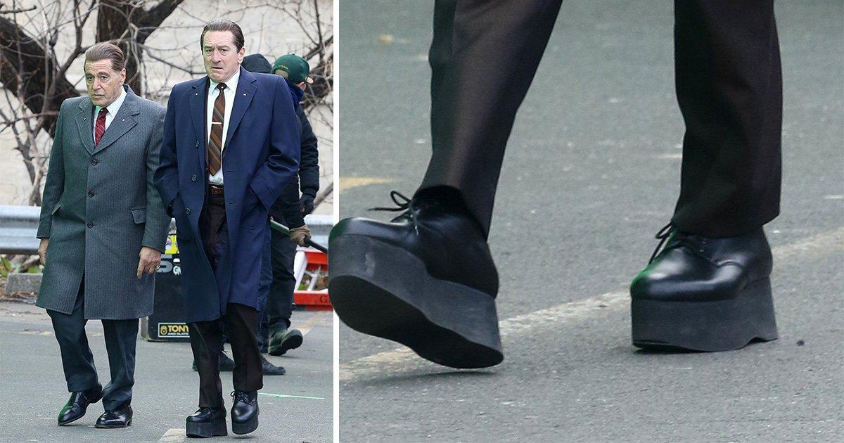 Robert De Niro wears giant platform shoes to make him taller as he films with Al Pacino