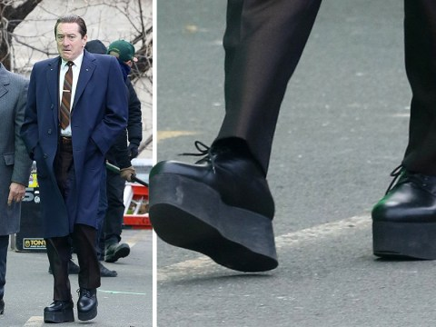 Robert De Niro wears giant platform shoes to make him taller as he films with Al Pacino