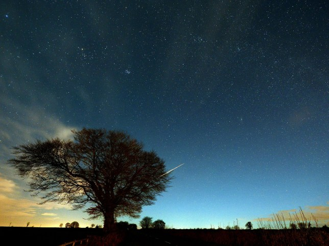 Meteor shower at night