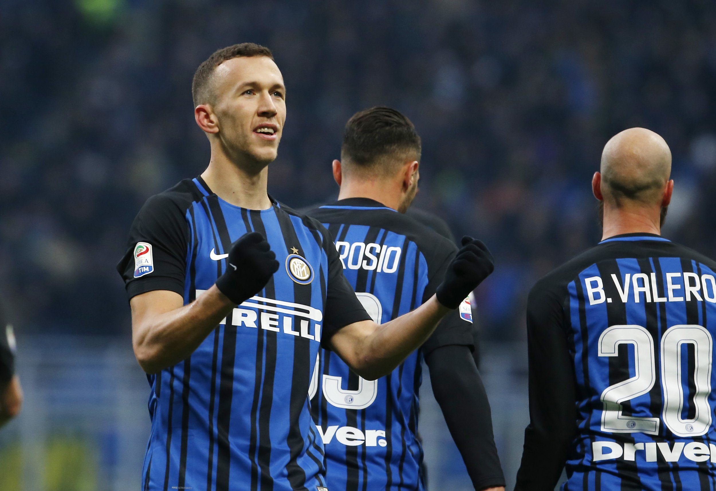 Ivan Perisic looks at the fans with his fists clenched