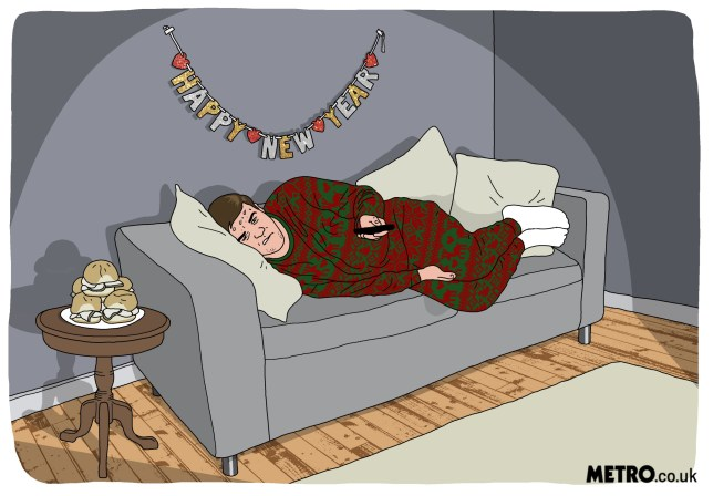 Young guy on sofa in Christmas onesie sweating with TV remote in hand and turkey sandwiches on table with Happy New Year banner on wall