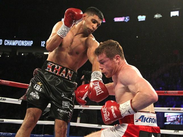Amir Khan punches Canelo Alvarez