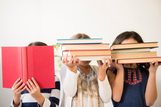 Picture of three girls holding books