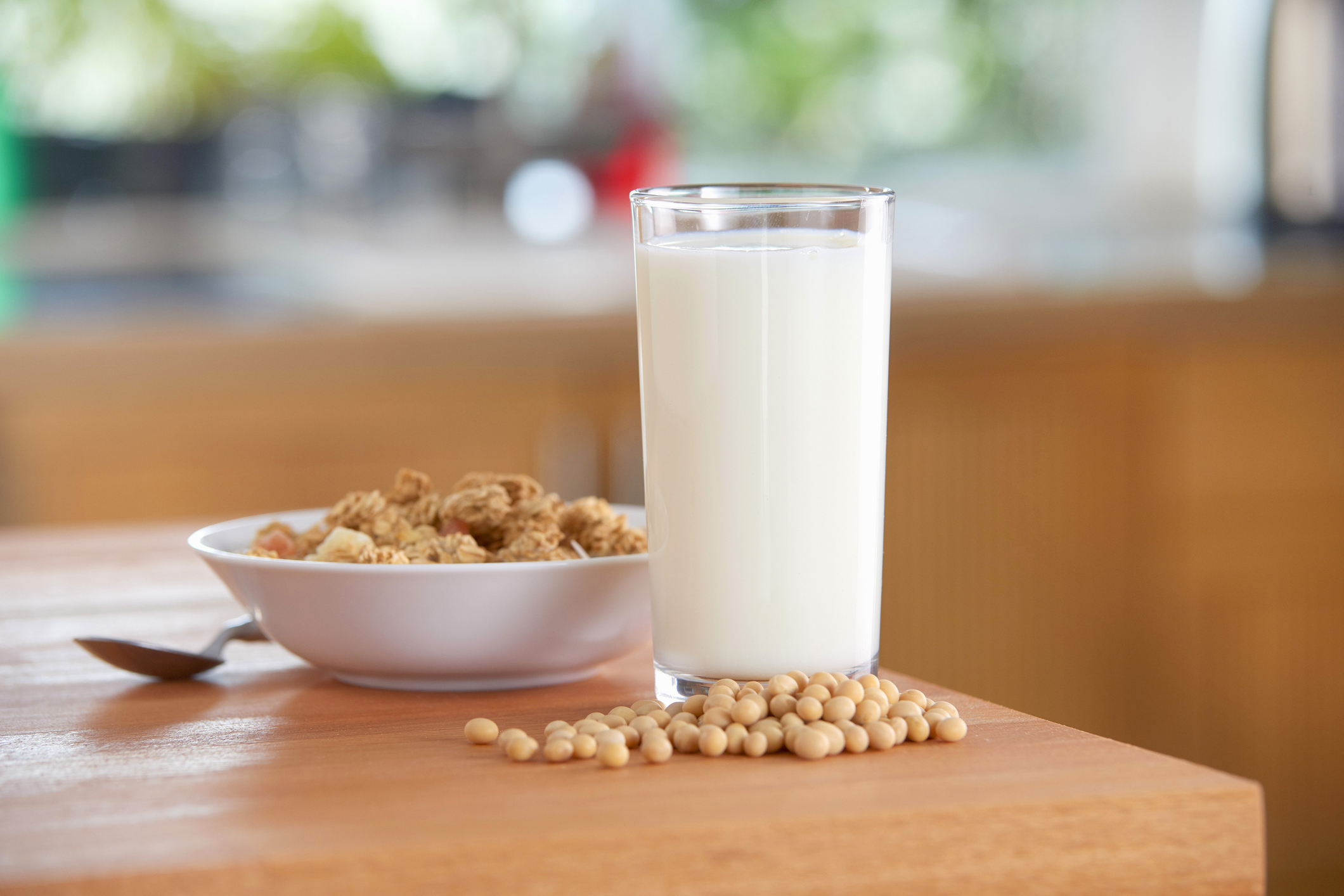 """""""A glass of soya milk, soya beans and cereals"""""""