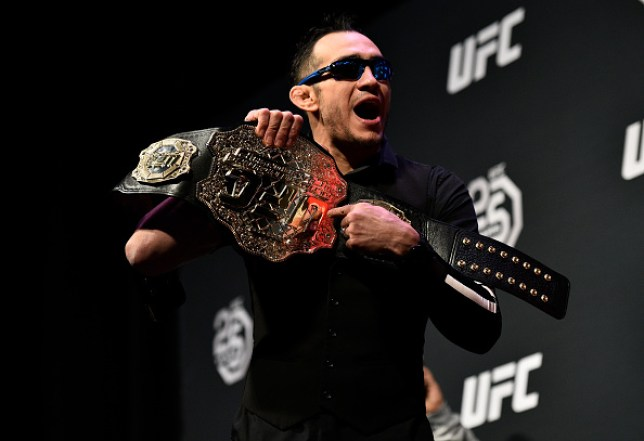 Tony Ferguson taunting and pointing at his belt