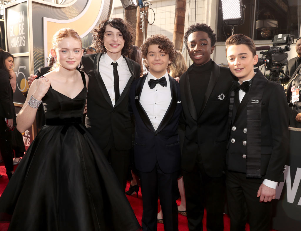The Stranger Things cast looked pretty dapper as they graced the Golden Globes red carpet