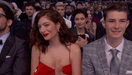 Lorde channels Rihanna by rocking a matching flask at the Grammys