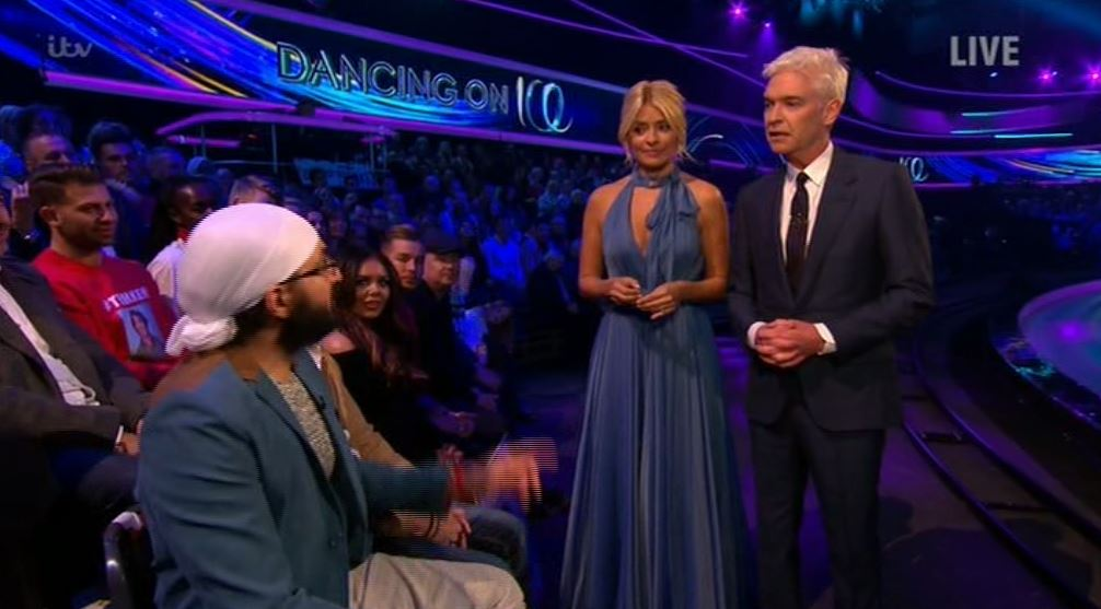 Monty Panesar left red-faced after he wrongly guesses Dancing On Ice host Philip Schofield's age – to his face