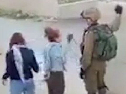 Palestinian teenager charged over viral video of her slapping Israeli soldier