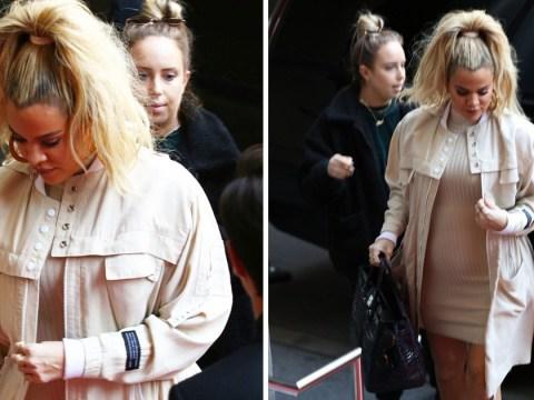 Pregnant Khloe Kardashian is glowing as she finally stops hiding baby bump