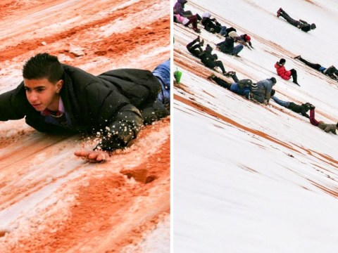 Children in the Sahara desert have the time of their lives after freak snow storm