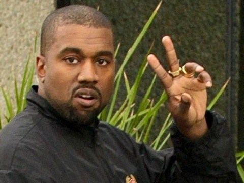 Kanye West shows off an uncharacteristic smile as he heads to work following birth of baby girl