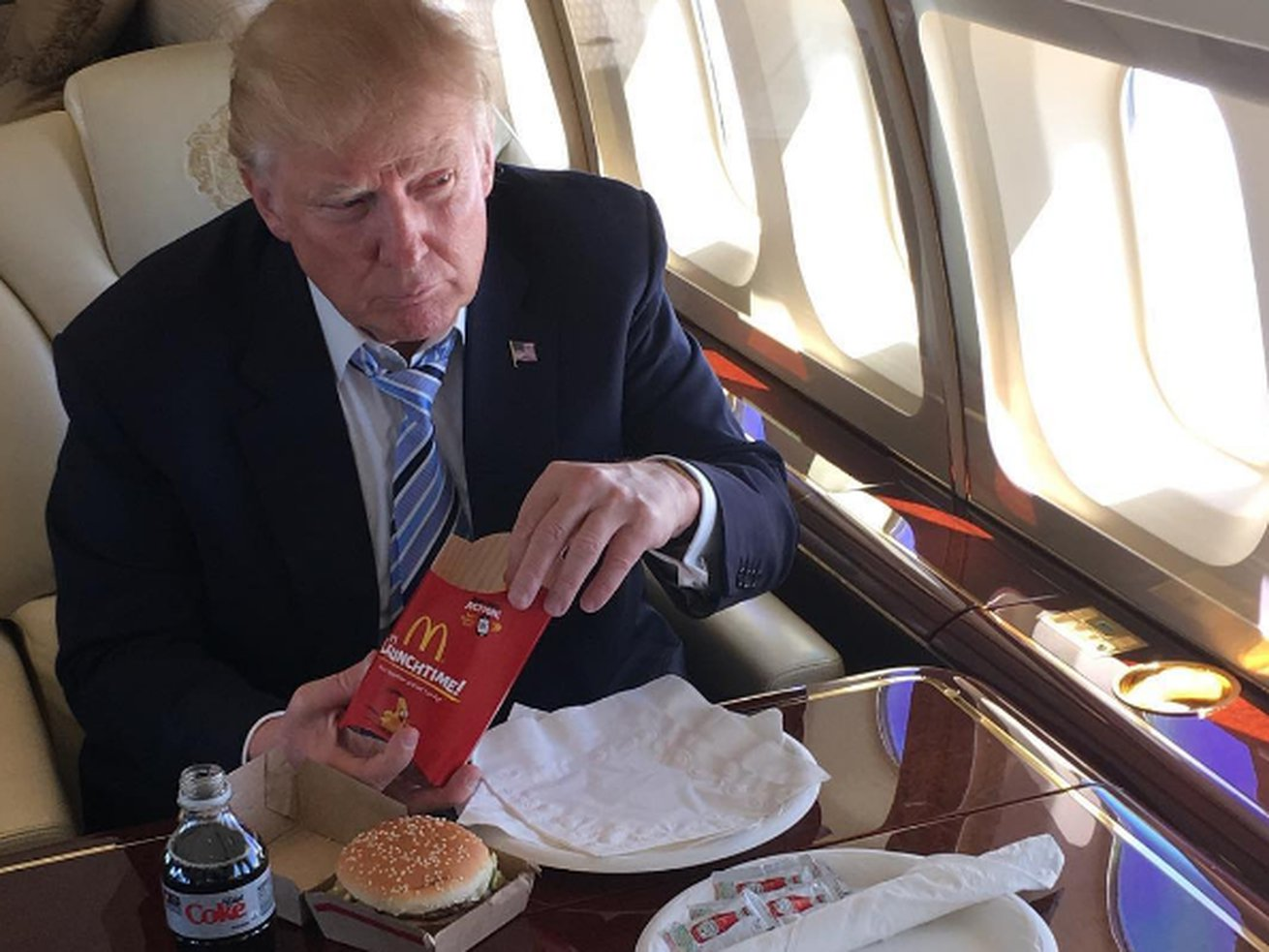 Donald Trump 'eats cheeseburgers in bed for dinner while watching three TVs'