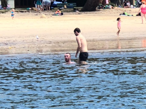Sam Smith has romance On His Mind as he frolics in the sea with boyfriend Brandon Flynn