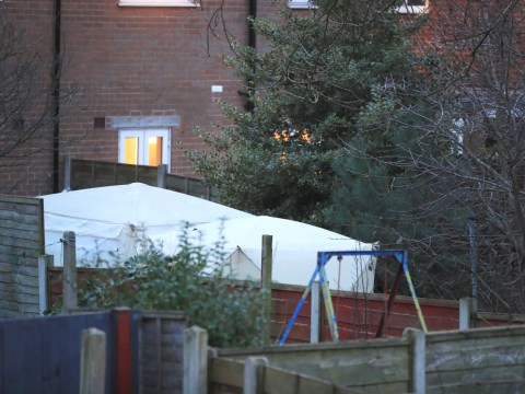 Woman denies killing 'war hero' dad whose body was found in back garden