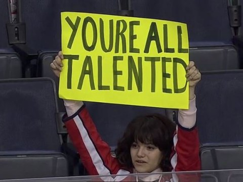 It's a sign! American highschooler brings the most positive message to a hockey game