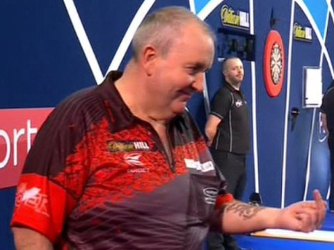 Phil Taylor gives crowd member the finger during PDC World Championship final defeat