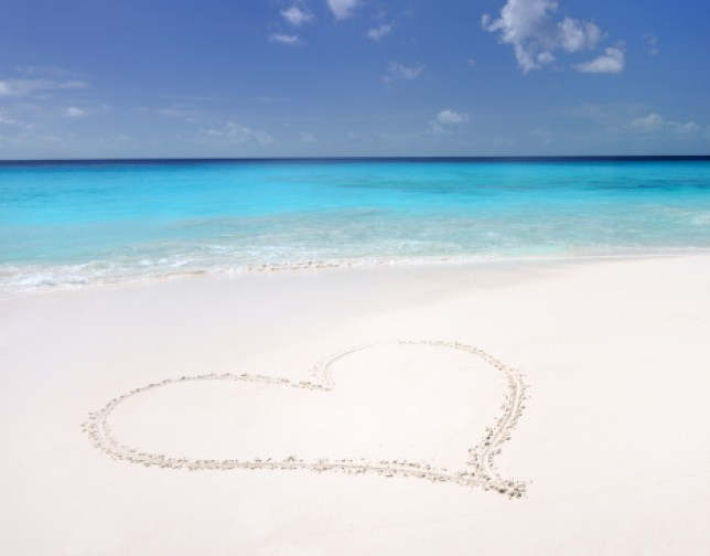 A heart drawn in the sand on the beach