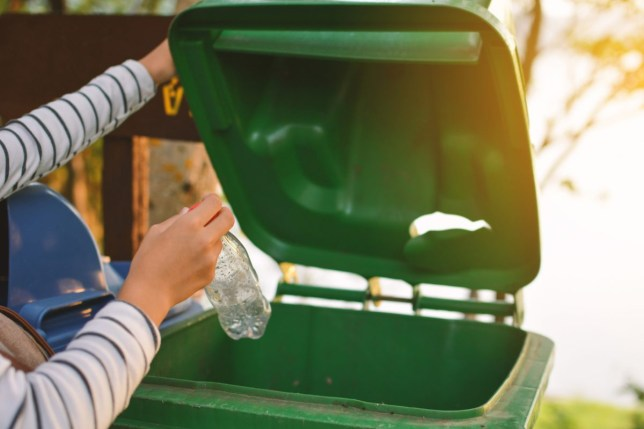 Woman putting recycling in the recycling bin