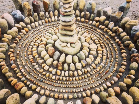 Keep your eyes peeled for these stunning mandalas made up of stones and leaves