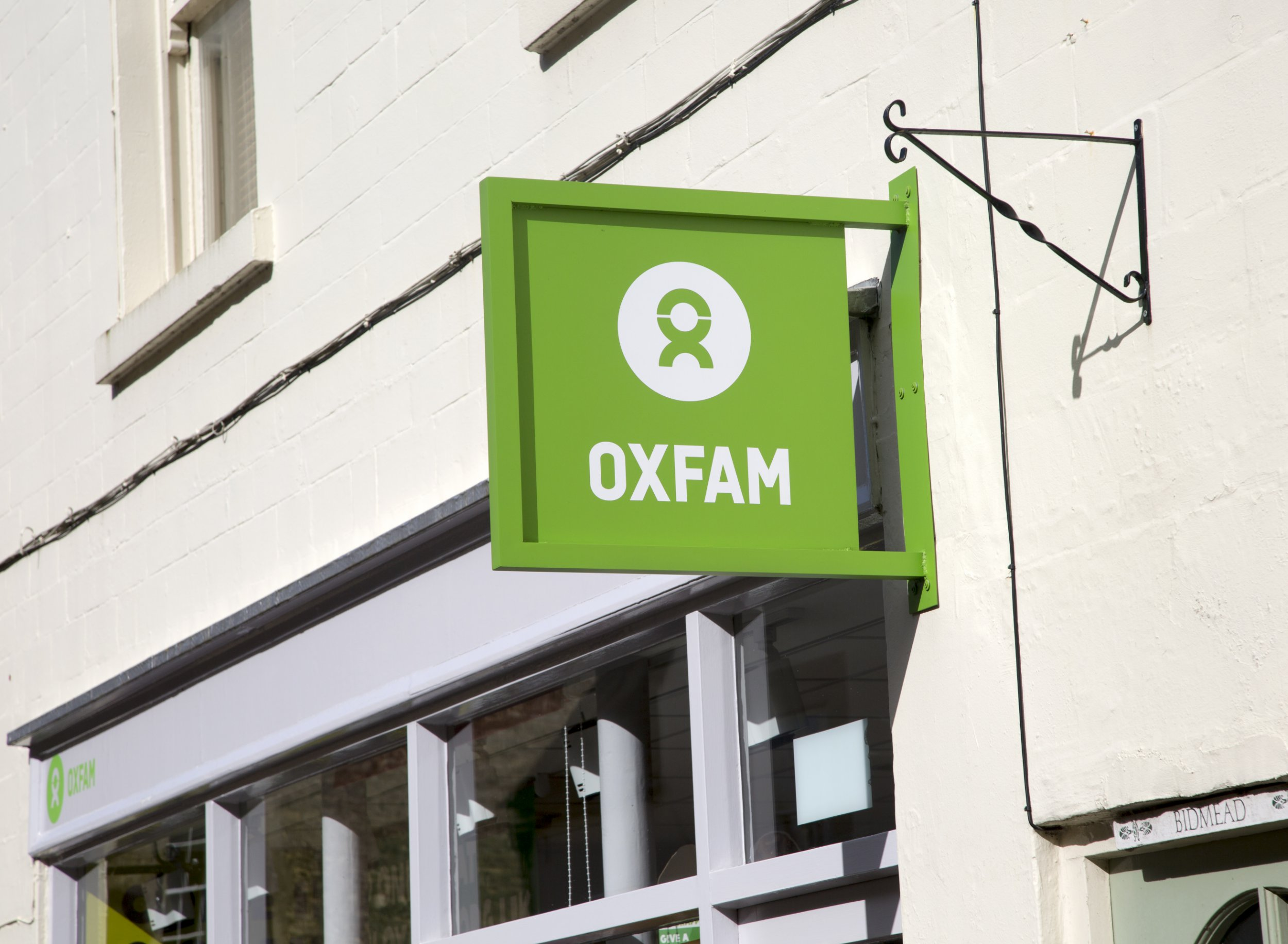 What does Oxfam stand for and what was the CEO's salary in 2017?