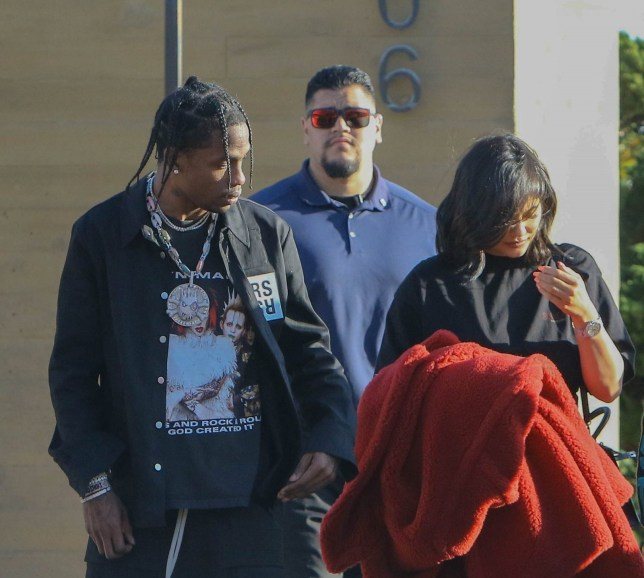 Malibu, CA - New parents Kylie Jenner and Travis Scott cover their faces as they exit Nobu in Malibu after lunch with friends. Pictured: Travis Scott, Kylie Jenner BACKGRID USA 24 FEBRUARY 2018 BYLINE MUST READ: LESE / BACKGRID USA: +1 310 798 9111 / usasales@backgrid.com UK: +44 208 344 2007 / uksales@backgrid.com *UK Clients - Pictures Containing Children Please Pixelate Face Prior To Publication*